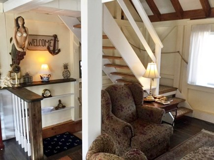 Truro Cape Cod vacation rental - Sitting area and stairs to 3rd floor
