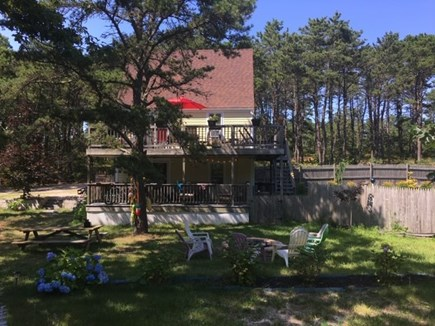 Truro Cape Cod vacation rental - Back of the house; view of 2 decks, fireplace and yard