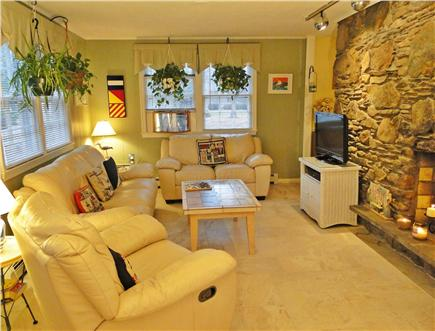 West Brewster/East Dennis Cape Cod vacation rental - Family room with fireplace, bay window, TV