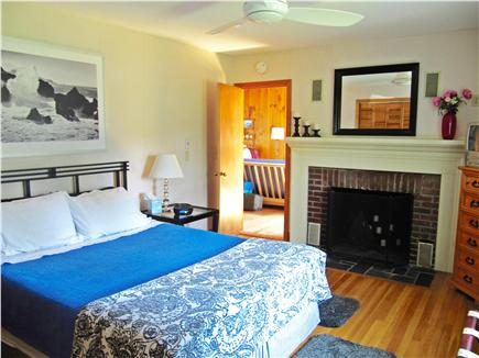 Brewster Cape Cod vacation rental - Master suite w/comfy queen bed (& en suite bathrm) off living rm.