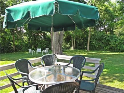 Brewster Cape Cod vacation rental - Dining area on rear deck under giant silver maple tree.