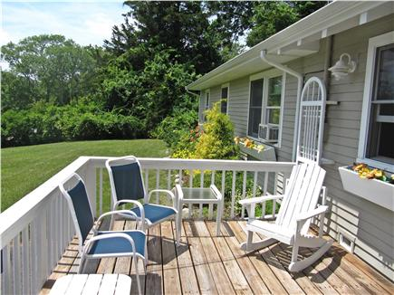 Brewster Cape Cod vacation rental - South facing front deck and garden off driveway area.