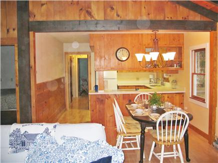 Brewster Cape Cod vacation rental - View across dining area into kitchen and down bedroom hallway.