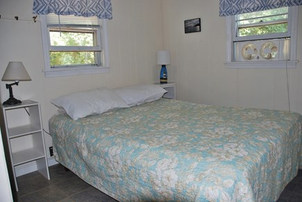 Eastham Cape Cod vacation rental - Main bedroom; Window fan, closet, drawers, & shelves