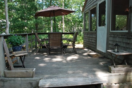 Eastham Cape Cod vacation rental - Deck; picnic table in yard great for preparing a lobster dinner!