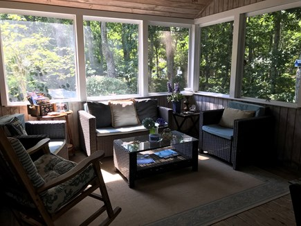 Eastham Cape Cod vacation rental - Cozy living area in screened in porch. Electric heater.