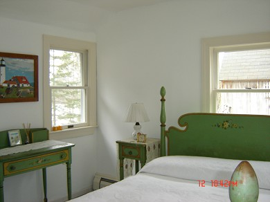 Harwich, MA Cape Cod vacation rental - A vintage bedroom with a full bed has a peek of the pond.