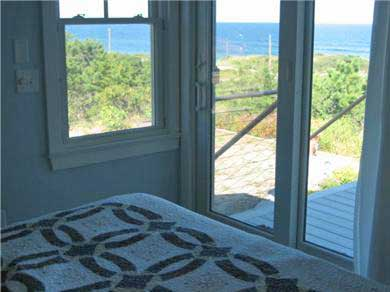 Wellfleet Cape Cod vacation rental - King bedroom with slider that opens onto deck.