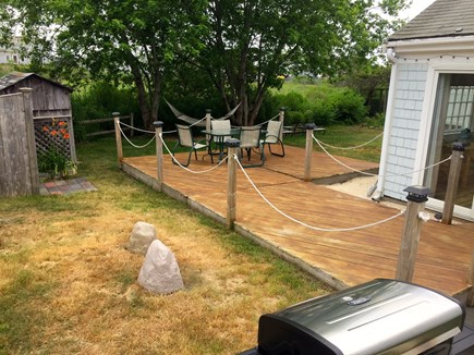 West Yarmouth Cape Cod vacation rental - Backyard deck. Other side of the house is all lawn 4 yard games.
