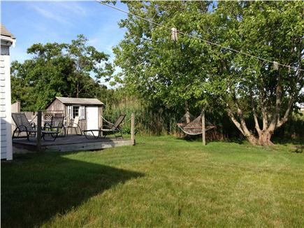 West Yarmouth Cape Cod vacation rental - Backyard deck, plenty of lawn to play, and a hammock to relax in.