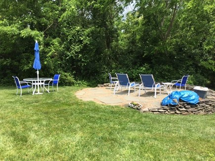 Dennis Bayside Cape Cod vacation rental - Patio area with firepit and spacious yard