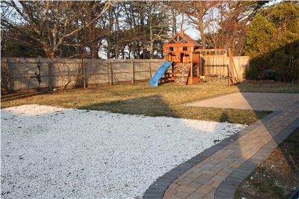 Downtown Chatham Cape Cod vacation rental - New Walkway, clam shell driveway and view of fenced in yard