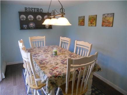 Downtown Chatham Cape Cod vacation rental - Dining area with table for 6 and slider to backyard