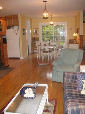 Dennisport Cape Cod vacation rental - Open living, dining and kitchen area w/French Doors to Patio