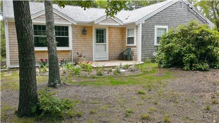 Eastham, Great Pond Area Cape Cod vacation rental - Front of house with perennial garden and hydrangeas