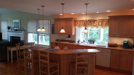 North Eastham Cape Cod vacation rental - Kitchen and living room viewed from porch entry