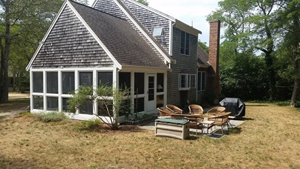 North Eastham Cape Cod vacation rental - Backyard with flagstone patio and new weber gas grill