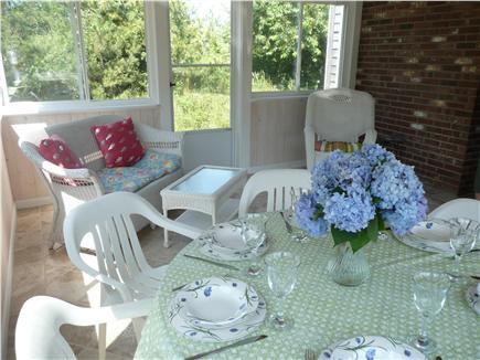 Eastham Cape Cod vacation rental - Screened in porch with wicker sitting area