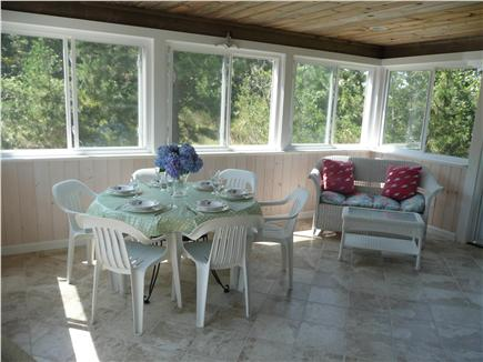 Eastham Cape Cod vacation rental - Screened in porch dining area