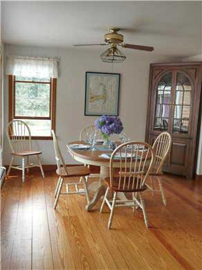 Eastham Cape Cod vacation rental - Sunny dining area with bay window views of deck and yard
