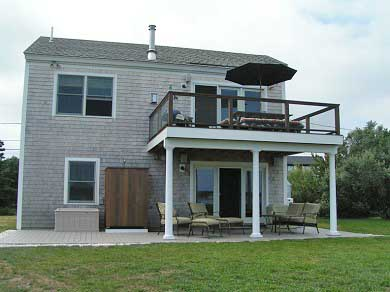 Wellfleet Cape Cod vacation rental - Back of house facing the water with 2 decks and outside shower