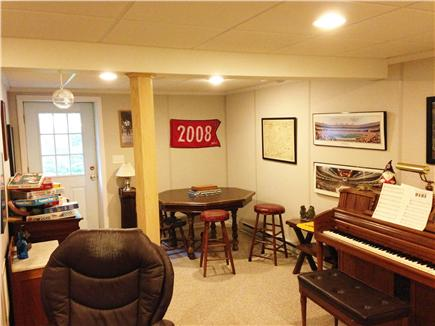 Harwich Cape Cod vacation rental - Poker table and piano add to the fantastic downstairs area.