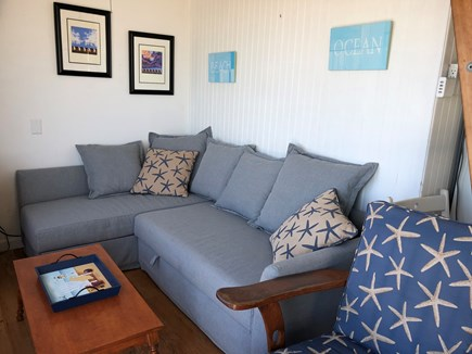 Truro Cape Cod vacation rental - Living room with chaise sofa that opens to a queen bed