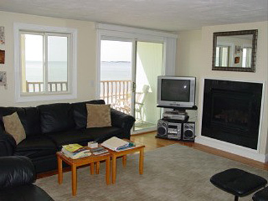 Truro Cape Cod vacation rental - Living area with sliders to deck and view