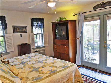 Chatham Cape Cod vacation rental - Large main floor king master BR w/ bathroom, TV & door to deck