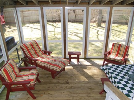 Falmouth New Silver Beach Cape Cod vacation rental - A favorite place to sit – porch overlooking yard