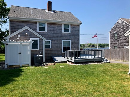West Yarmouth Cape Cod vacation rental - Large Back Yard. Outdoor shower. Deck to watch the sunset
