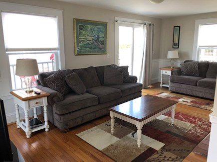 West Yarmouth Cape Cod vacation rental - Living Room leading to deck.