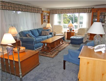 South Chatham Cape Cod vacation rental - Spacious living room w/ water views, fireplace & sliders to deck
