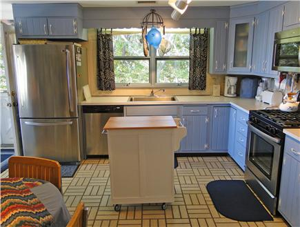 South Chatham Cape Cod vacation rental - Roomy kitchen w/ quaint dining table for two – perfect for kids