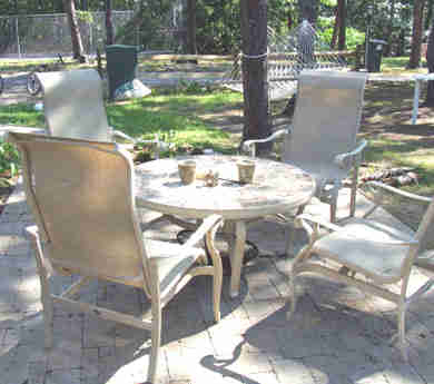 Eastham Cape Cod vacation rental - Shaded patio with fire pit/table