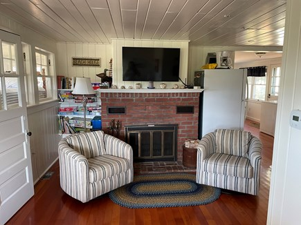 Wellfleet Cape Cod vacation rental - A conversation area with fireplace
