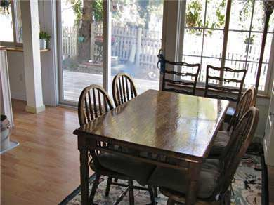 Eastham Cape Cod vacation rental - Bright light dining/kitchen with sliders to deck