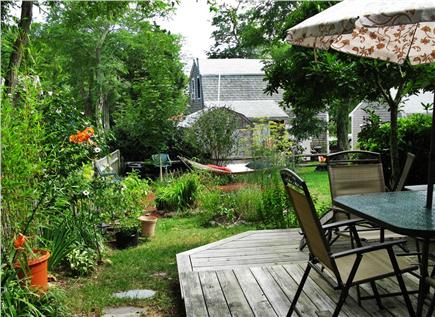 Eastham Cape Cod vacation rental - Back deck for cookouts & relaxing, including hammock in the yard