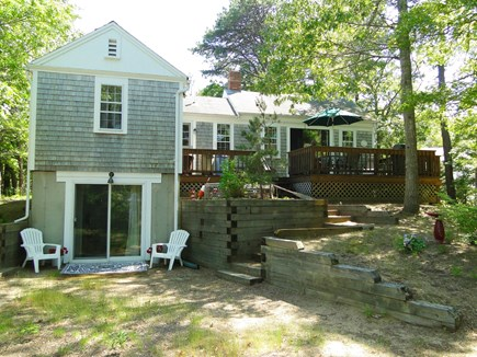 Eastham Cape Cod vacation rental - Rear view of cottage showing deck, large yard, and lower level