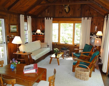 Eastham Cape Cod vacation rental - Living room w/ cathedral ceiling, dining table, sliders to deck