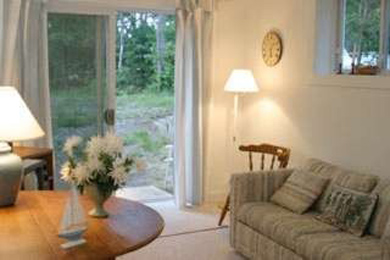 Eastham Cape Cod vacation rental - View of  living room with slides to hammock and backyard