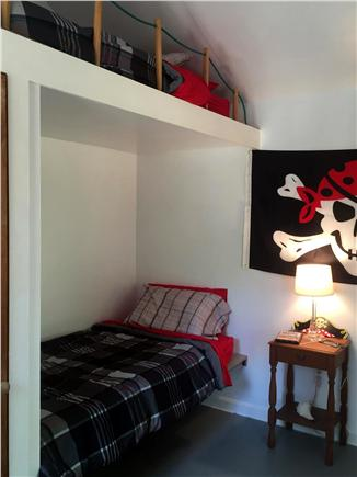 Dennisport Cape Cod vacation rental - Bunkhouse w electricy 2 twin beds, ladder and closet w shelves.