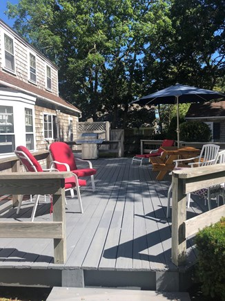 Dennisport Cape Cod vacation rental - Spacious deck for grilling, eating and visiting outdoors.