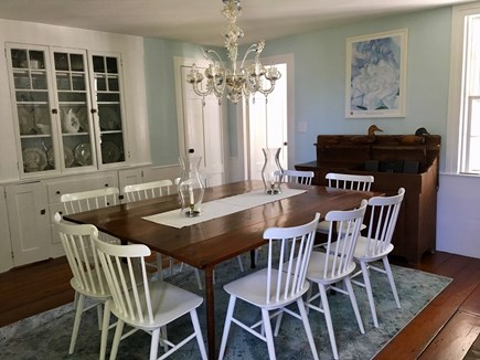 Truro Cape Cod vacation rental - A Venetian chandelier lights the dining room.