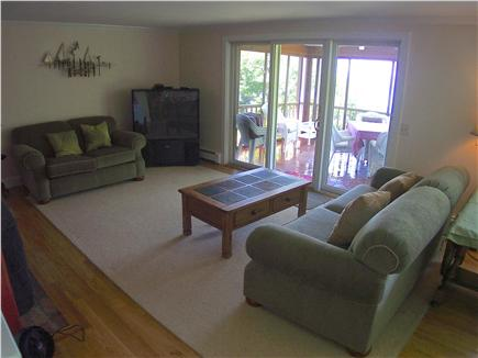 Brewster Cape Cod vacation rental - Open floor plan flows out to screened porch (first photo above)