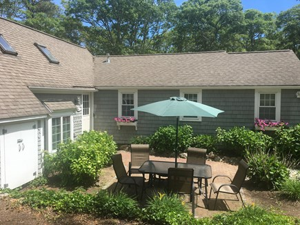 New Seabury, Mashpee, Poppy New Seabury vacation rental - 5BR: This is one of three private patios surrounded by flowers