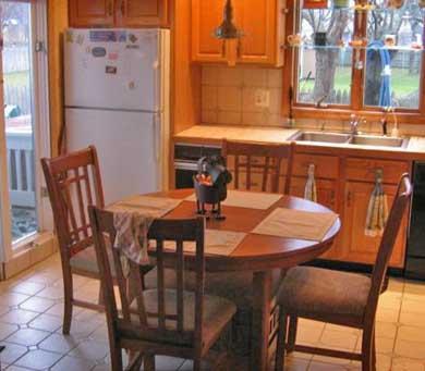Dennis Cape Cod vacation rental - Eat-in kitchen with slider to deck