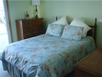 Mashpee, Popponesset Cape Cod vacation rental - Master bedroom with ocean views and slider access to the deck