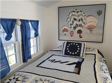 Falmouth Heights Cape Cod vacation rental - Queen sized bedroom off of kitchen with ceiling fan