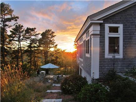 Wellfleet Cape Cod vacation rental - Private yard at sunset, umbrella table and zero gravity chairs